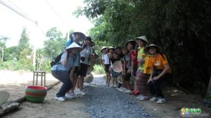 Girls from Paya Lebar Methodist School were building road in Phuong Thinh Commune (Dong Thap province).