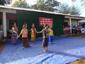 The children was performing a folk dance.