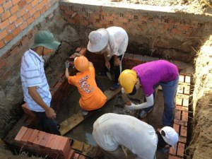 The volunteers are actively building house