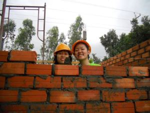 Happiness shines on these faces when building up a house by their own hands